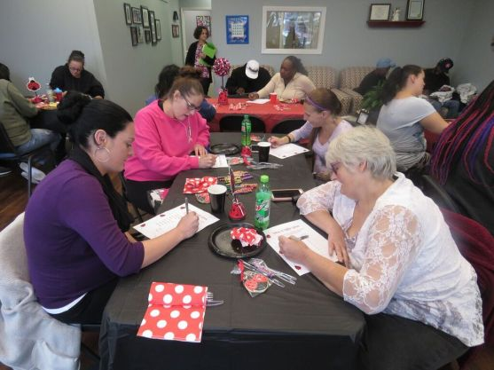 Expectant moms and guests play lovebug baby bingo
